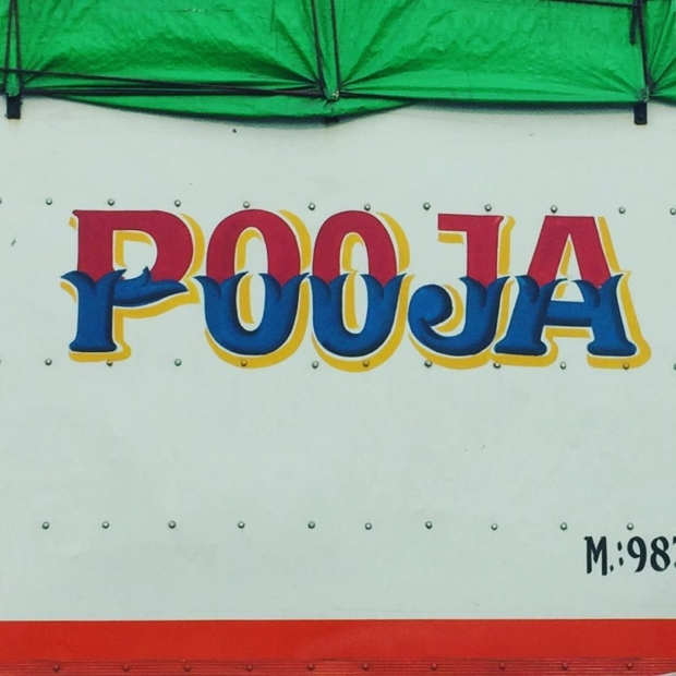 Pooja. From the side of a truck